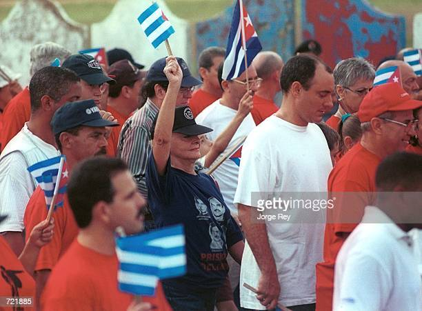 Dalia Soto del Valle Fidel Castro's wife waves a Cuban flag during a march in front of the Interests Section building on the Malecon June 12 2002 in...