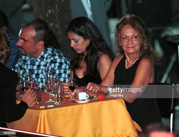 Dalia Soto del Valle sits with her and Fidel Castro''s son Alexander and an unidentified friend during the Habanos SA event February 2001 at the...