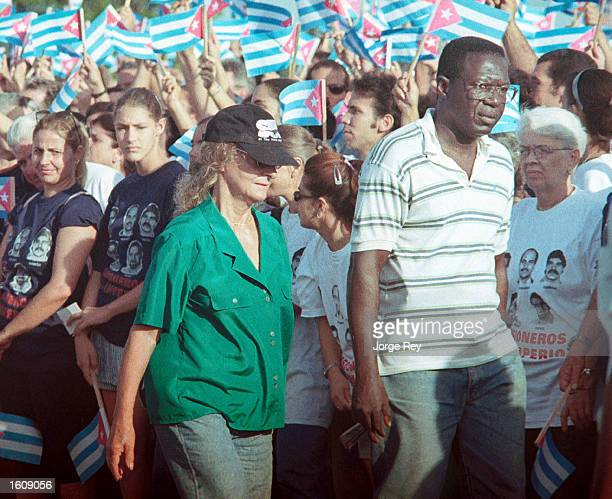 Dalia Soto del Valle walks with an unidentified friend during a political rally July 7 2001 in Bejucal Town outside of Havana Cuba Soto del Valle has...