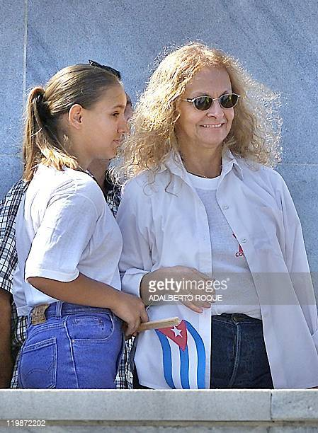 Dalia Soto del Valle wife of Cuban President Fidel Castro flanked by one of Castro's granddaugthers attends May Day celebrations 01 May 2002 in...