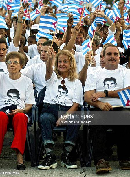 Dalia Soto del Valle wife of Cuban President Fidel Castro waves flag during the inauguration of the new school year in Havana 16 September 2002...
