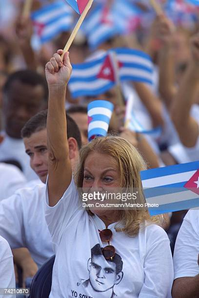 Dalia Soto del Valle wife of Fidel Castro waves a flag as her husband Dr Fidel Castro Ruz President of the Republic of Cuba gives a speech to launch...