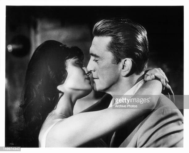 Daliah Lavi and Kirk Douglas share a kiss in a scene from the film 'Two Weeks In Another Town' 1962