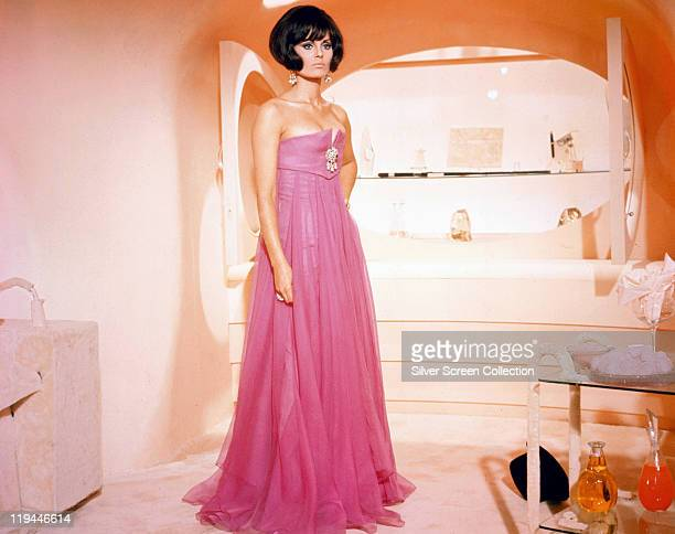 Daliah Lavi Israeli actress singer and model wearing a fulllength pink shoulderless dress circa 1965