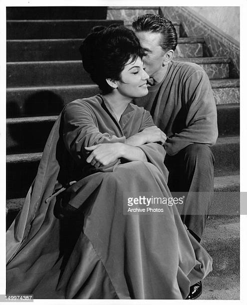 Daliah Lavi smiles as Kirk Douglas whispers in her ear in a scene from the film 'Two Weeks In Another Town' 1962