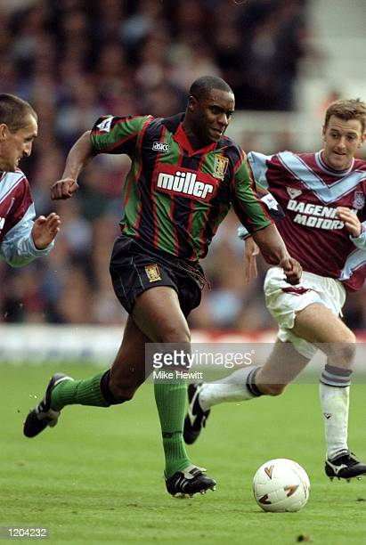Dalian Atkinson of Aston Villa makes a break during an FA Carling Premiership match against West Ham United at Upton Park in London Mandatory Credit...