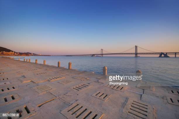 dalian xinghai bay bridge and seawall - seawall stock pictures, royalty-free photos & images