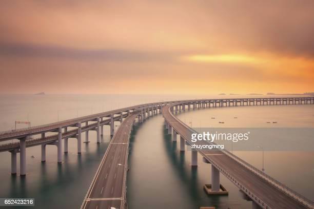 dalian xinghai bay bridge - dalian stock photos and pictures