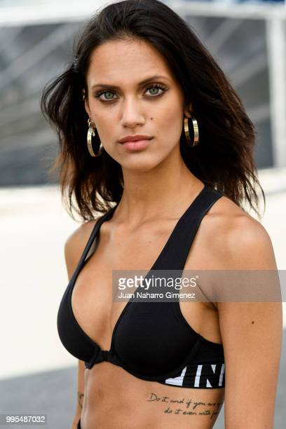 Dalianah Arekion wears slippers Victoria's Secret trousers and top during the Mercedes Benz Fashion Week Spring/Summer 2019 at IFEMA on July 10 2018...