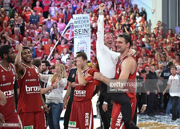 Dalibor Bagaric of Brose Baskets Bamberg celebrates winning the German basketball championship 2015 with head of baord Max Stoschek after Game Five...