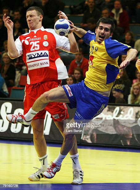 Dalibor Doder of Sweden in action with Szabolcs Zubai of Hungary during the Men's Handball European Championship main round Group II match between...
