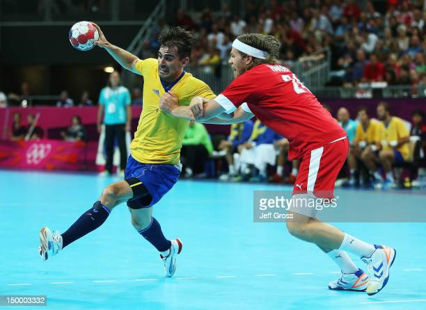 Dalibor Doder of Sweden is pursued by Mikkel Hansen of Denmark during the Men's Quarterfinal match between Sweden and Denmark on Day 12 of the London...