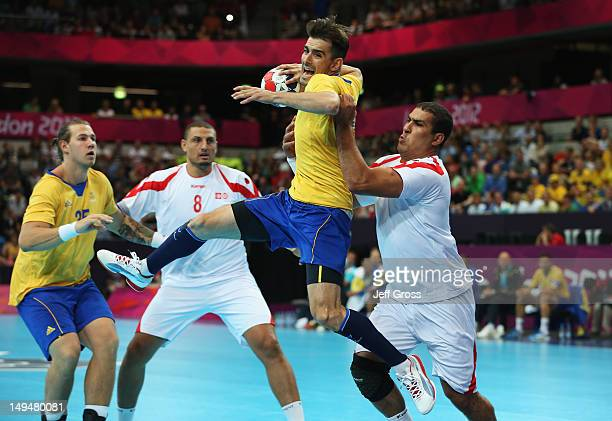 Dalibor Doder of Sweden jumps to shoot during the Men's Handball preliminaries group A match between Sweden and Tunesia on Day 2 of the London 2012...