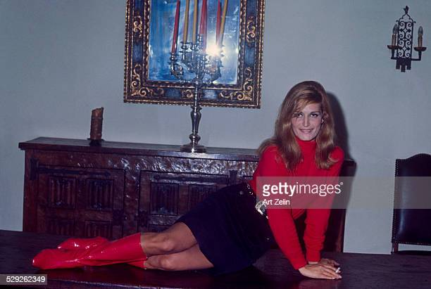 Dalida; a singer; on a table posing for the photo; circa 1970; New York.