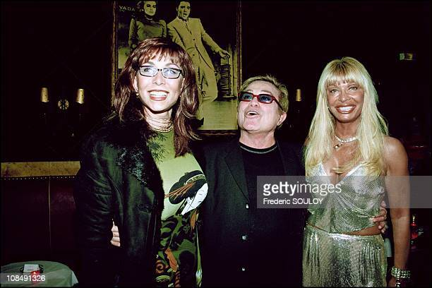 Dalida's brother Orlando standing between a friend and Lova Moor in Paris, France on March 07th, 2001.
