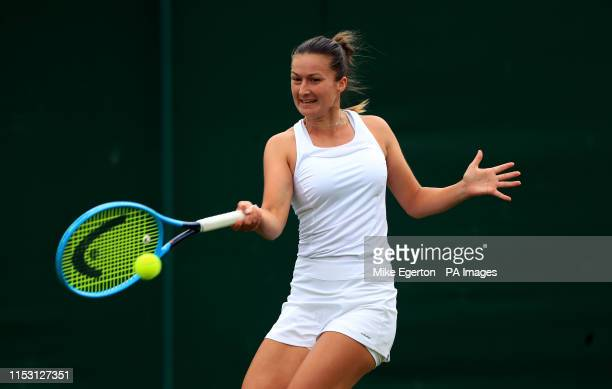 Dalila Jakupovic in action on day one of the Wimbledon Championships at the All England Lawn Tennis and Croquet Club Wimbledon