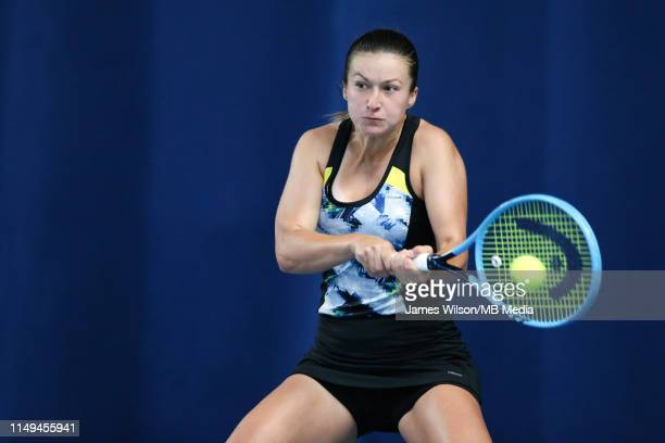 Dalila Jakupovic of Slovakia in action against Donna Vekic of Croatia during day three of the Nature Valley Open at Nottingham Tennis Centre on June...