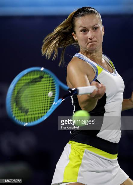 Dalila Jakupovic of Slovenia plays a shot in her match against Angelique Kerber of Germany during day three of the WTA Dubai Duty Free Tennis...