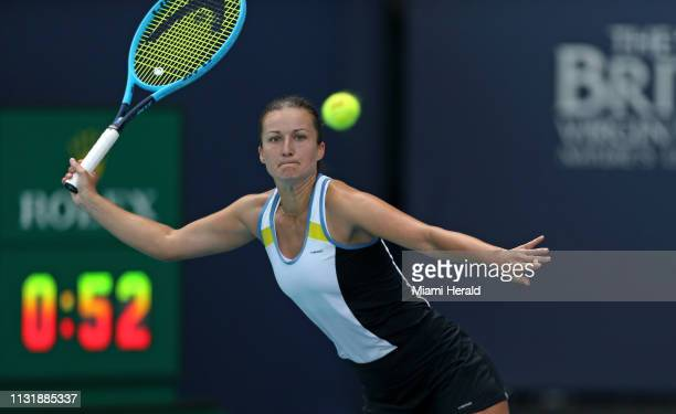 Dalila Jakupovic of Slovenia returns a shot to Venus Williams of the United States during their match at Miami Open tennis tournament on Thursday...