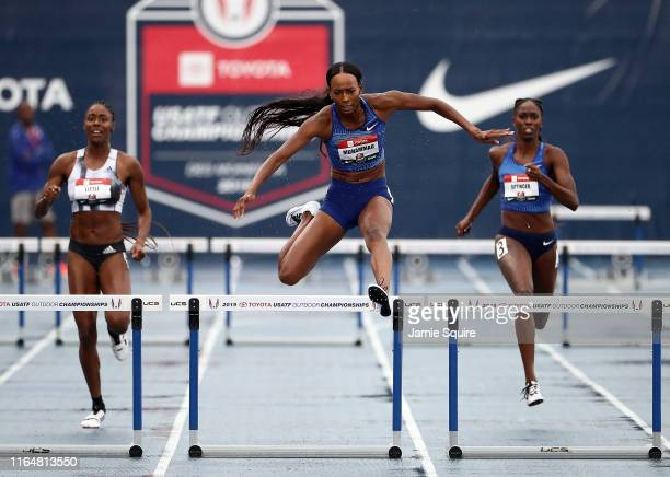 Dalilah Muhammad clears the last hurdle on her way toward winning the Women's 400 Meter Hurdles and setting a new World Record of 52.20 during the...