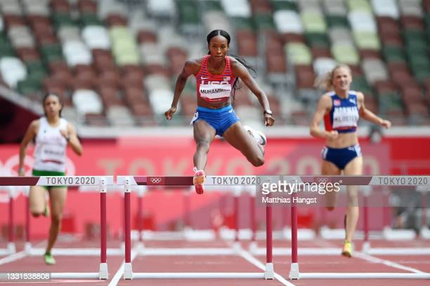 Dalilah Muhammad of Team United States competes in round one of the Women's 400m hurdles heats on day eight of the Tokyo 2020 Olympic Games at...