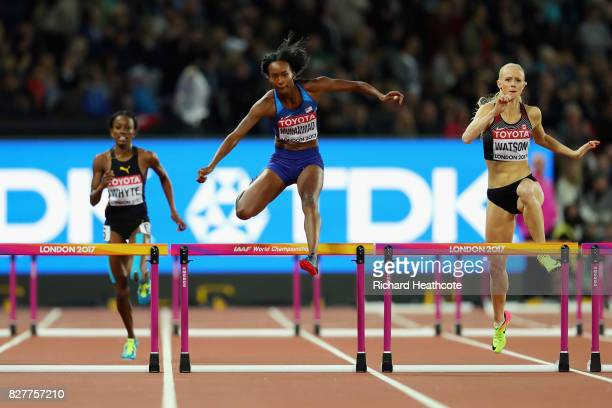Dalilah Muhammad of the United States and Sage Watson of Canada compete in the Women's 400 metres hurdles semi finals during day five of the 16th...