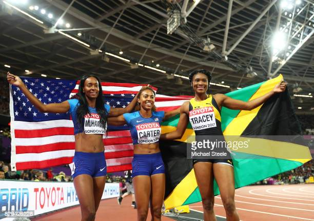 Dalilah Muhammad of the United States Kori Carter of the United States and Ristananna Tracey of Jamaica celebrate after the womens 400 metres hurdles...