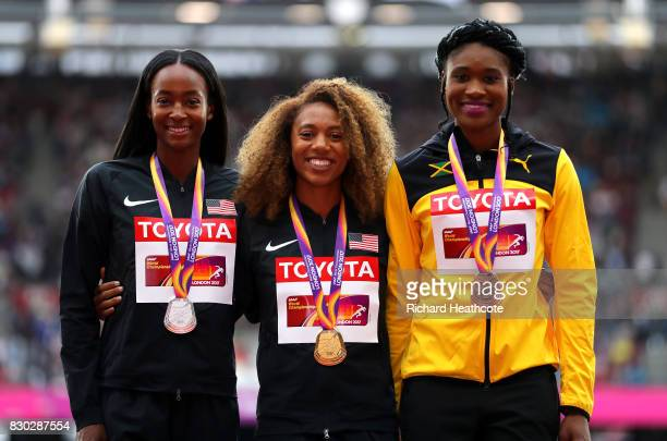 Dalilah Muhammad of the United States silver Kori Carter of the United States gold and Ristananna Tracey of Jamaica bronze pose with their medals for...