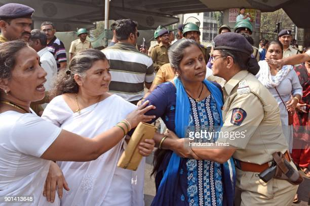 Dalit activists argue with the policeman during protest on Western Express Highway at Bandra as they demand arrested of Sambhaji Bhide and Milind...