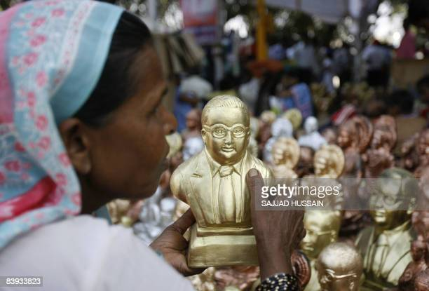 A dalit lowcaste or the oppressed Hindu women buys a statue of B R Ambedkar to a customer at a homage site in Mumbai on December 6 2008 Hindus at the...