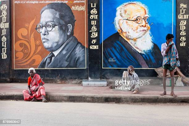 Dalit people sitting by wall paintings of Dr Ambedkar and Erode Venkata Ramasamy both famous for their fight against discrimination and for justice...