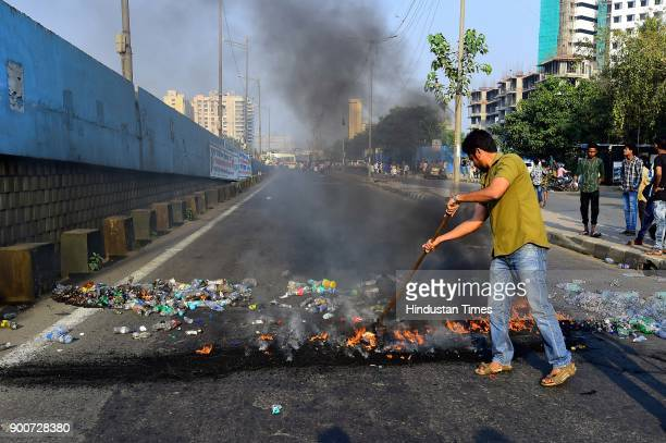 Dalit protesters burn plastic garbag to block Eastrnexpress highway near Siddhart colony at Chembur after the clashes between Dalit groups and...