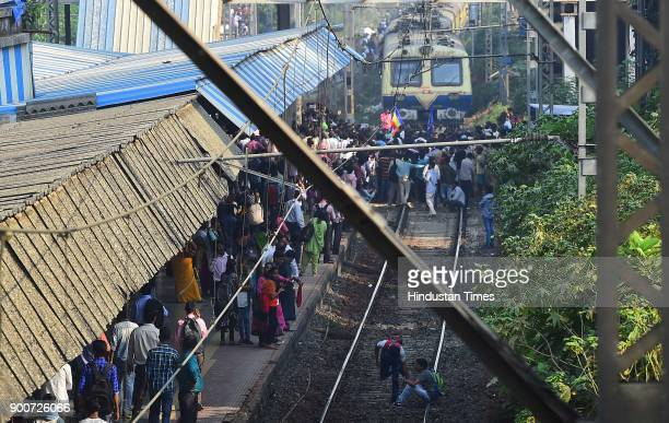 Dalit protesters staged rail roko at Chembur Sation after the clashes between Dalit groups and supporters of rightwing Hindutva organisations broke...