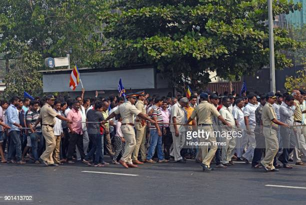 Dalit protestors block the road on Western Express Highway at Bandra as they demand arrested of Sambhaji Bhide and Milind Ekbote on January 4 2018 in...