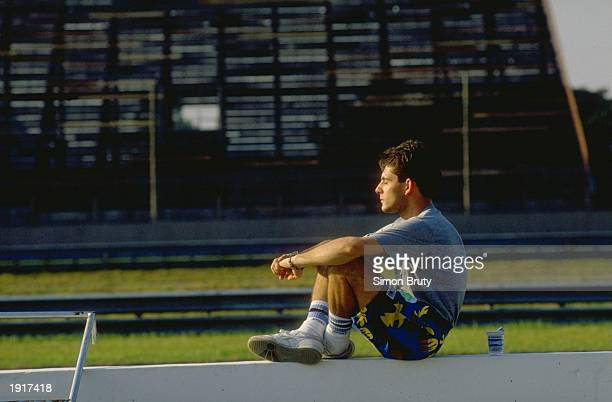 Dallara Cosworth driver Alex Caffi of Italy relaxes in the sun before the Brazilian Grand Prix at the Rio circuit in Brazil Caffi did not qualify...