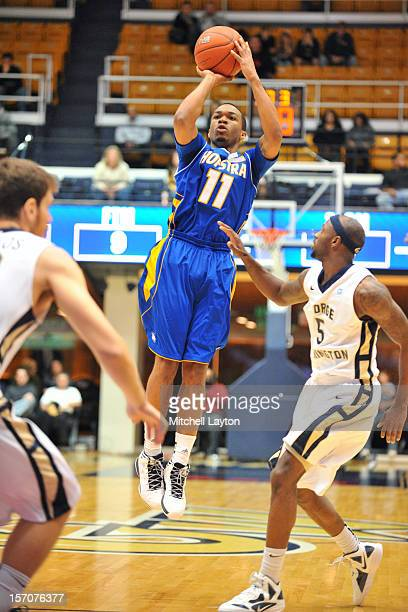 Dallas Anglin of the Hofstra Pride takes a jump shot during a college basketball game against the George Washington Colonials on November 24 2012 at...