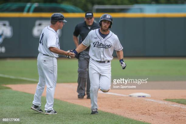 Dallas Baptist outfielder Austin Listi rounds the bases after hitting a home run during the NCAA Division 1 baseball tournament regional game between...