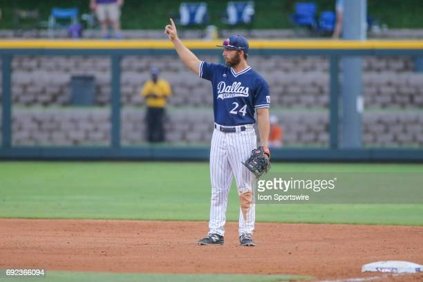 Dallas Baptist outfielder Austin Listi signals one out to his team during the NCAA Division 1 baseball tournament regional game between Dallas...