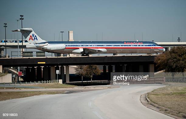 A Dallas based American Airlines jet crosses an overpass at DallasFort Worth International Airport in Dallas Texas US Thursday Nov 2009 Delta Air...