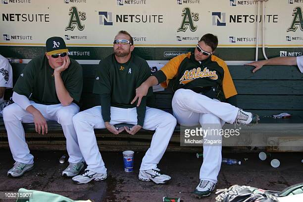 Dallas Braden of the Oakland Athletics showing his steel balls to Trevor Cahill and Landon Powell in the dugout prior to the game against the Chicago...