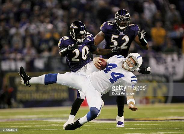 Dallas Clark of the Indianapolis Colts is knocked down by Ed Reed and Ray Lewis of the Baltimore Raves during their AFC Divisional Playoff game on...