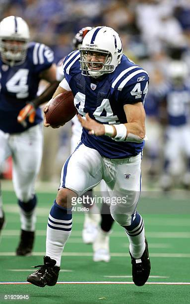 Dallas Clark of the Indianapolis Colts runs the ball down to the five yard line in the first quarter against the Denver Broncos during the AFC...