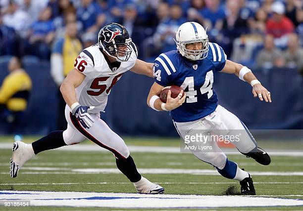 Dallas Clark of the Indianapolis Colts runs with the ball while defended by Brian Cushing of the Houston Texans during the NFL game at Lucas Oil...