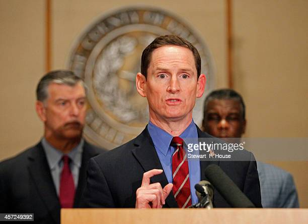 Dallas County Judge Clay Jenkins, flanked by Dallas Mayor Mike Rawlings and Dallas County Health and Human Services Director Zachary Thompson,...