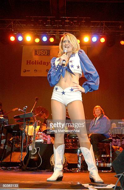 A Dallas Cowboy Cheerleader entertaining US Army troops during the USO Holiday Entertainment tour 2001