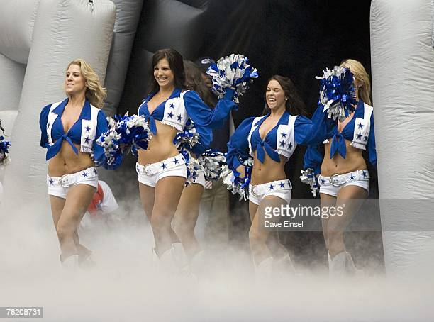 Dallas Cowboy cheerleaders perform during a preseason game against the Denver Broncos at Texas Stadium on August 18 2007 in Irving Texas