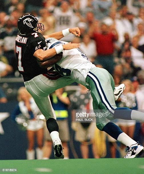 Dallas Cowboy defensive end Greg Ellis puts heavy pressure on Atlanta Falcons quarterback Tony Graziani during first quarter action at Texas Stadium...