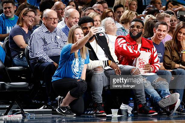 Dallas Cowboy Ezekiel Elliott takes a 'selfie' with a fan during the Houston Rockets game against the Dallas Mavericks on October 28 2016 at the...