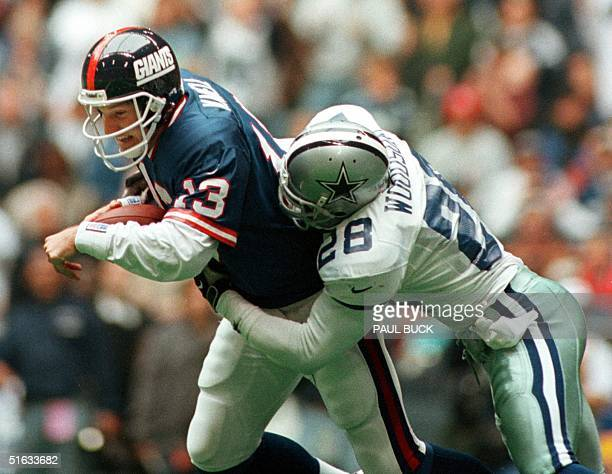 Dallas Cowboy safety Darren Woodson sacks New York Giants quarterback Danny Kanell for an eight yard loss during the second quarter of play at Texas...
