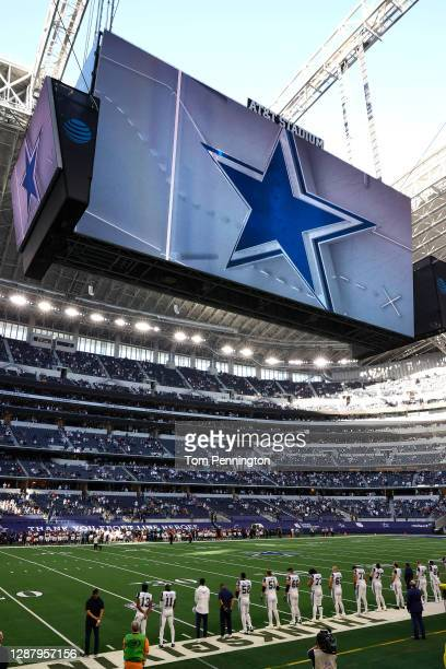 Dallas Cowboys are seen during the national anthem prior to facing the Washington Football Team at AT&T Stadium on November 26, 2020 in Arlington,...